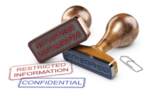 Two rubber stamps for Restricted Information and Confidential.